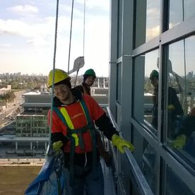 Barbas staff - cleaning windows of building