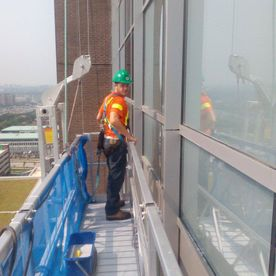 Josh - cleaning windows of an office building